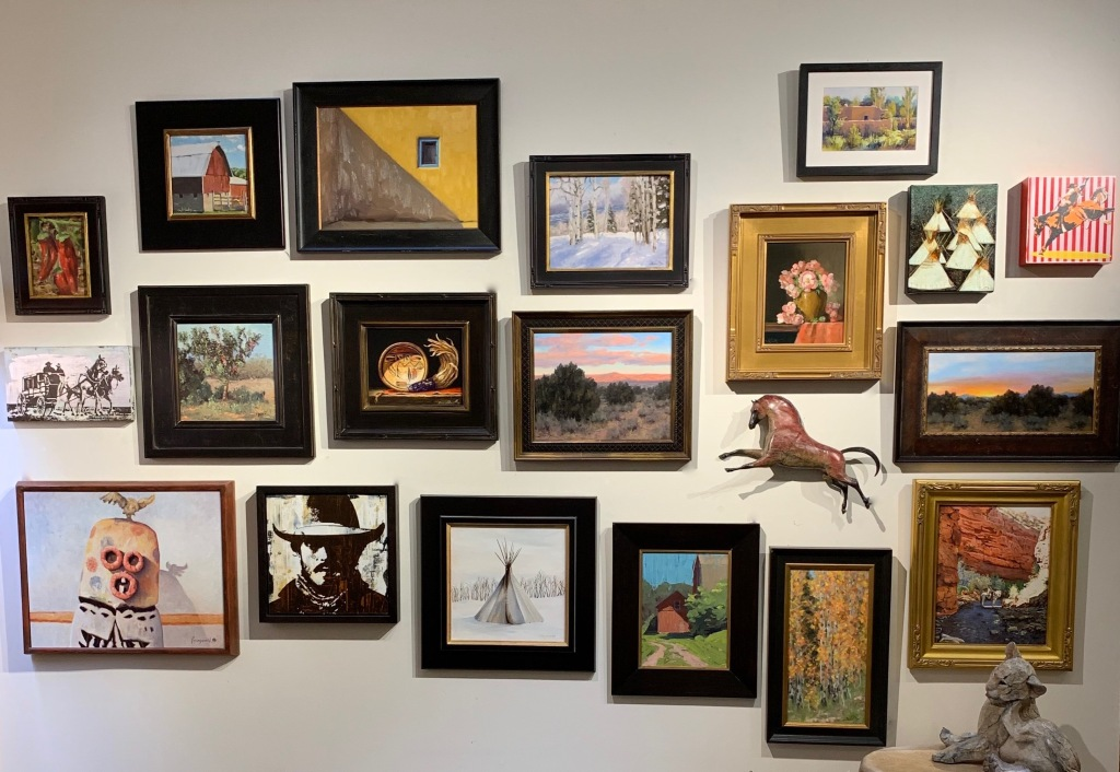 Gallery wall display at Sorrel Sky Gallery featuring two dimensional and three dimensional artwork.