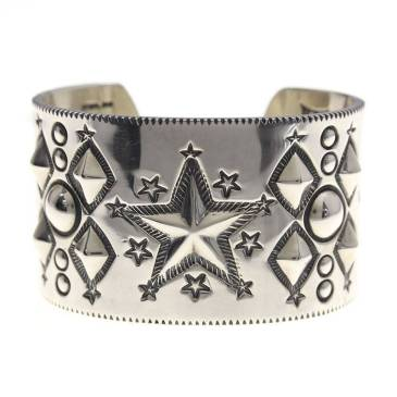 Wide sterling silver cuff bracelet with stars