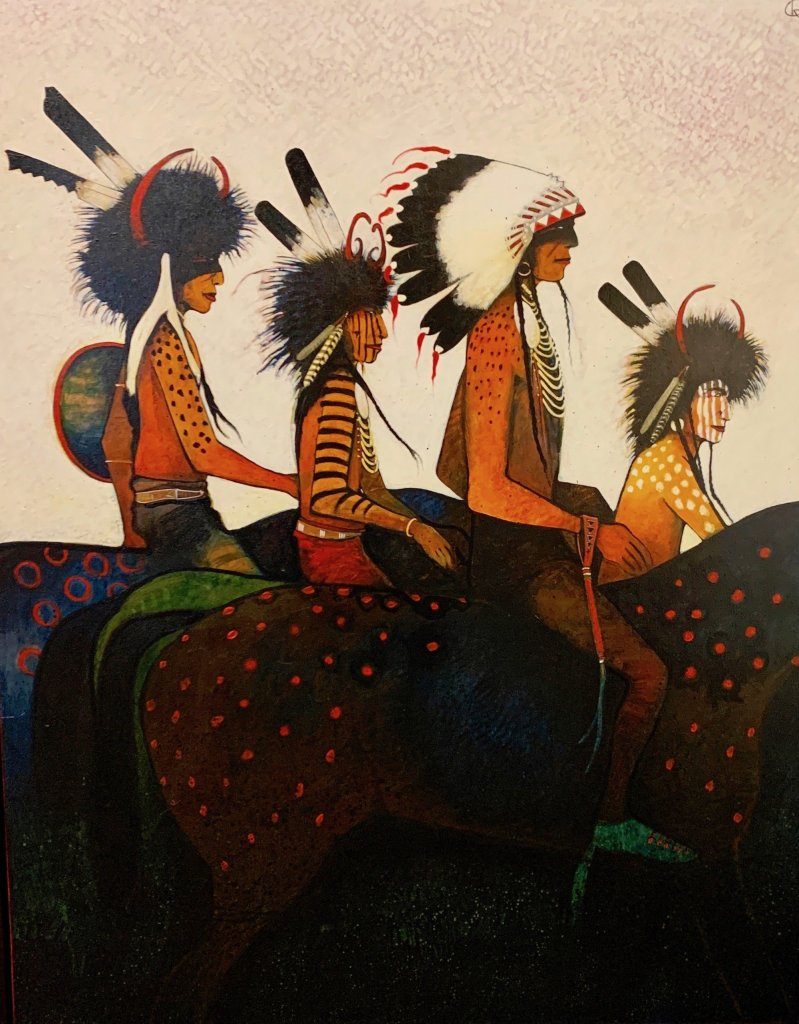 Painting of a Crow Indian Chief and 3 Medicine Helpers riding horses by Kevin Red Star as seen at Sorrel Sky Gallery