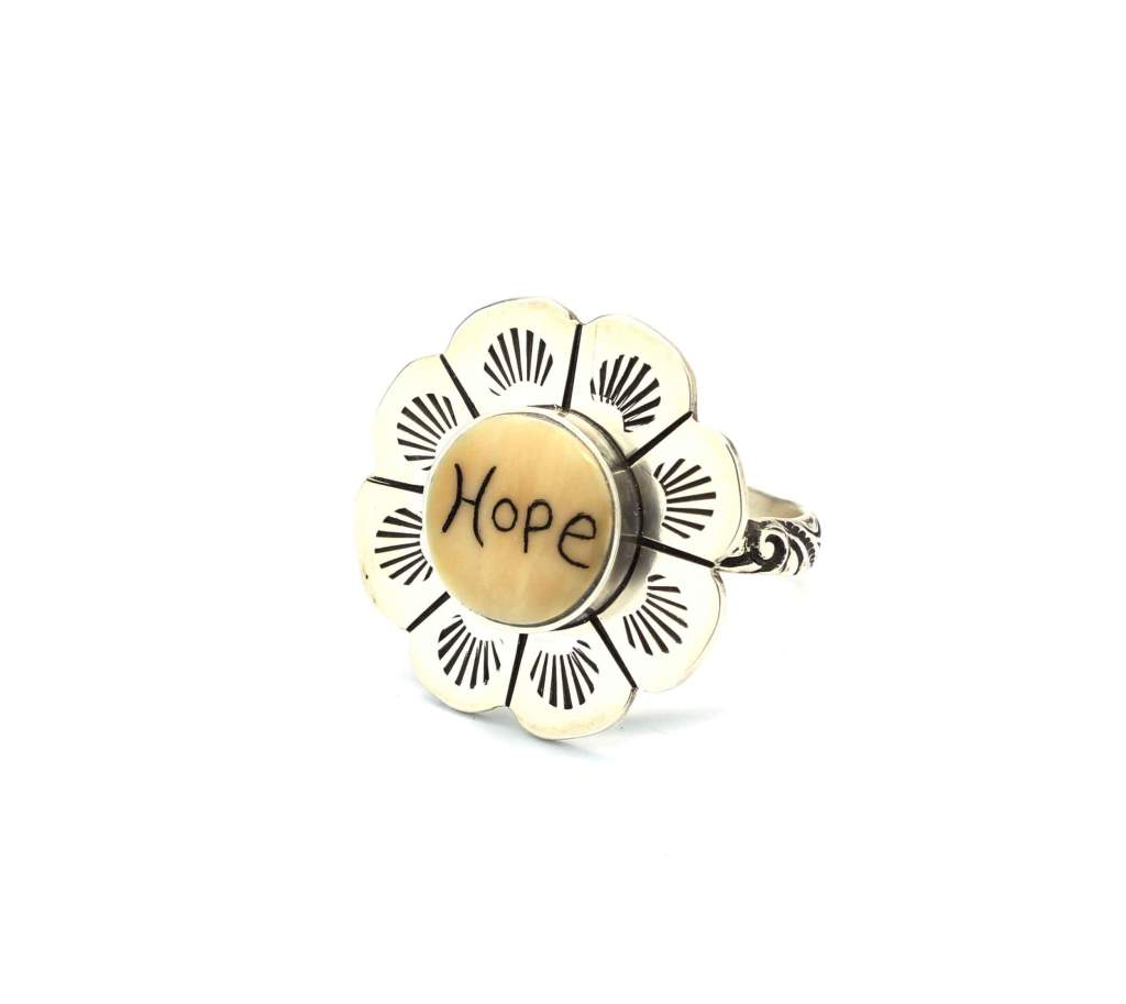 Flower ring with HOPE at the center by Michelle Tapia as seen at Sorrel Sky Gallery