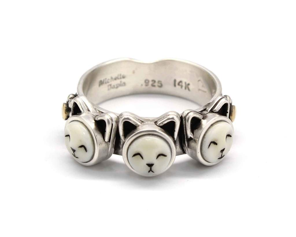 Sterling silver ring with the faces of three kittens by Michelle Tapia as seen at Sorrel Sky Gallery